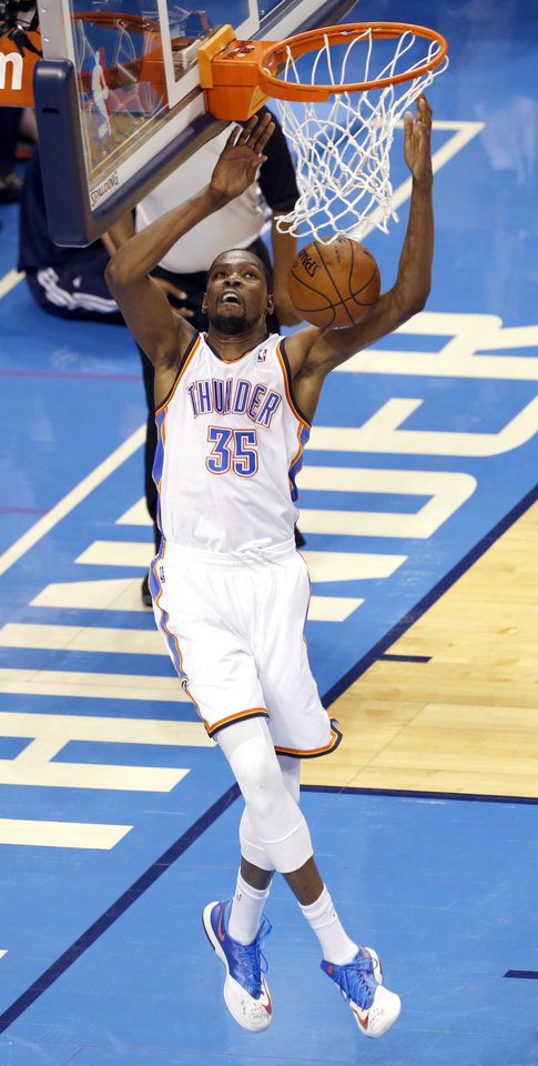 Photo - Oklahoma City's Kevin Durant (35) dunks during Game 6 of the Western Conference Finals in the NBA playoffs between the Oklahoma City Thunder and the San Antonio Spurs at Chesapeake Energy Arena in Oklahoma City, Saturday, May 31, 2014. Photo by Nate Billings, The Oklahoman