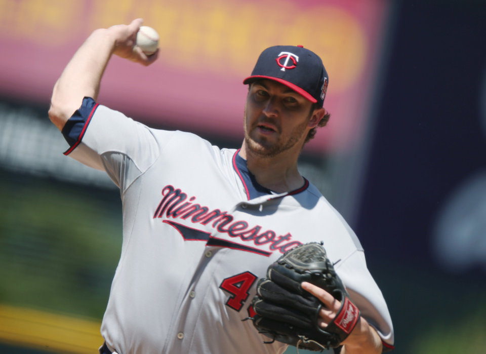 Photo - Minnesota Twins starting pitcher Phil Hughes works against the Colorado Rockies in the first inning of an interleague baseball game in Denver on Sunday, July 13, 2014. (AP Photo/David Zalubowski)