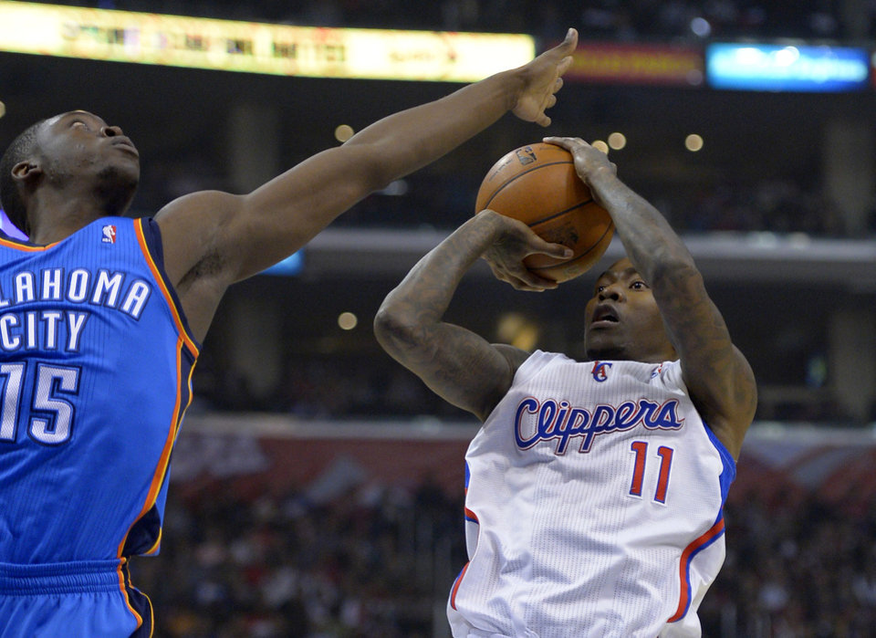 Los Angeles Clippers guard Jamal Crawford, right, puts up a shot as Oklahoma City Thunder guard Reggie Jackson defends during the first half of their NBA basketball game, Tuesday, Jan. 22, 2013, in Los Angeles. (AP Photo/Mark J. Terrill) ORG XMIT: LAS102
