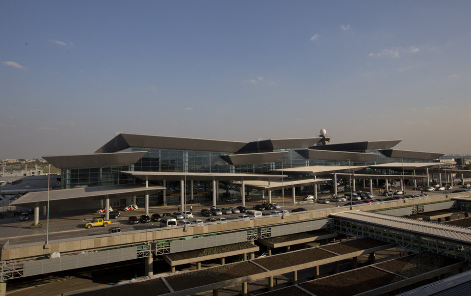 Photo - This photo shows a view of the new terminal 3 at the Sao Paulo International airport in Guarulhos, Brazil, Tuesday, May 20, 2014. The chronic delays in airport renovations have matched those in stadium construction, and officials have acknowledged for a while that visitors will be using unfinished airport facilities. Brazil is trying to assure World Cup tourists that they won't face problems at airports even though not all upgrades will be complete. (AP Photo/Andre Penner)