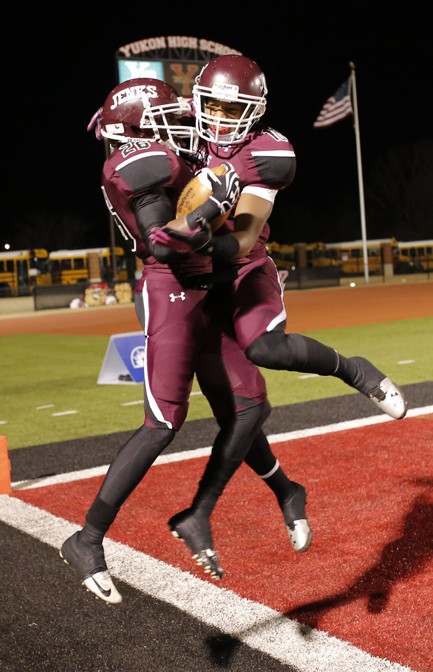 Photo - Jenks Steven Parker (10), right, celebrates a touchdown that Kalen McDavid (26) just scored during the 6A high school playoff game between Westmoore and Jenks at Yukon High School Friday November 29, 2013. Photo by Doug Hoke, The Oklahoman