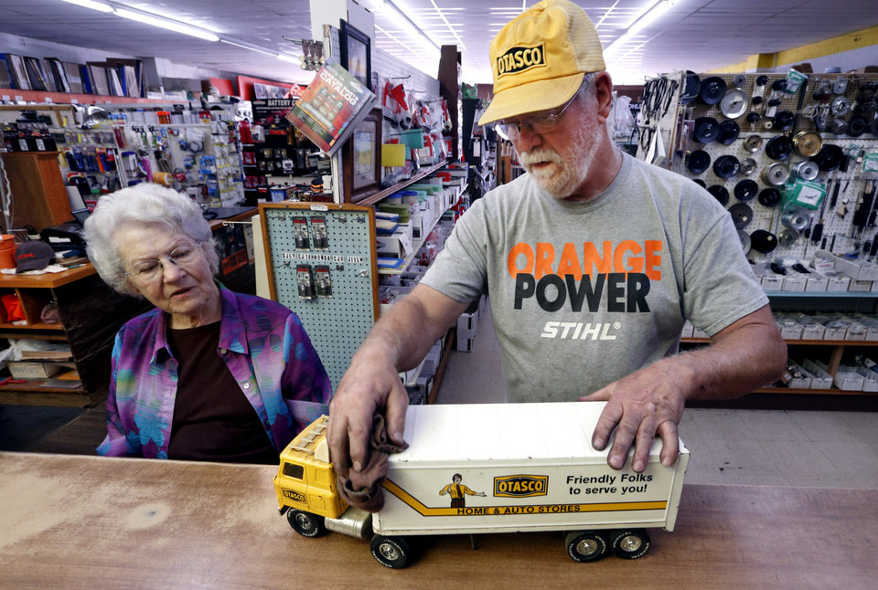Photo - Nancy Crow and son Mike look at an original OTASCO toy truck in her OTASCO store on Tuesday, July 8, 2014 in Marlow, Okla.  Photo by Steve Sisney, The Oklahoman