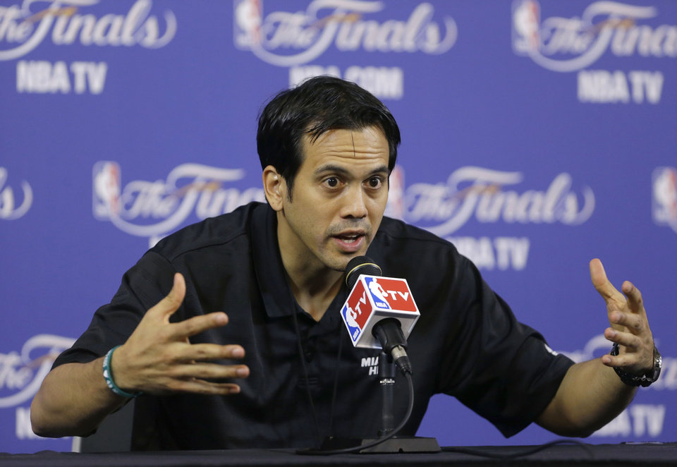 Photo - Miami Heat head coach Erik Spoelstra gestures as he speaks to members of the media during a news conference before team basketball practice, Wednesday, June 19, 2013 at the American Airlines Arena in Miami. The Heat and the San Antonio Spurs play Game 7 of the NBA Finals Thursday. (AP Photo/Wilfredo Lee)