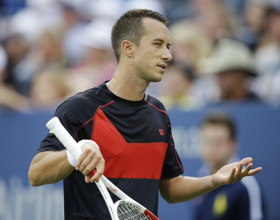 Photo - Philipp Kohlschreiber, of Germany, reacts after a shot against John Isner, of the United States, during the third round of the 2014 U.S. Open tennis tournament, Saturday, Aug. 30, 2014, in New York. (AP Photo/Darron Cummings)