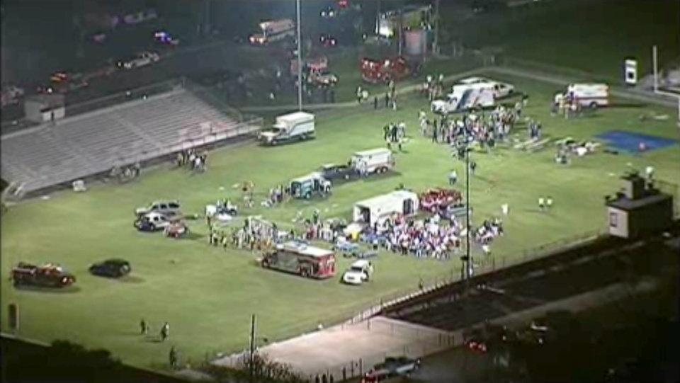 Photo - This video image provided by WFAA-TV shows injured people being treated on the flood-lit the high school football field turned into a staging area after the blast in West Texas Wednesday April 17, 2013. (AP Photo/WFAA-TV)