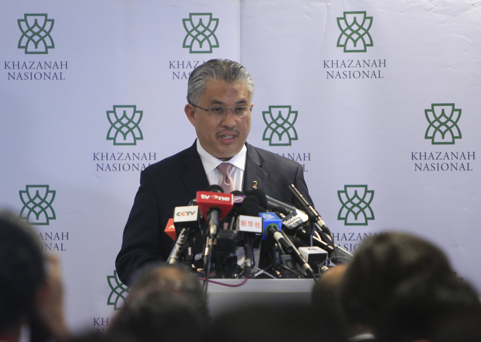 Photo - Managing Director of Khazanah Nasional, Berhad Azman Mokthar speaks during a press conference in Kuala Lumpur, Malaysia, Friday, Aug. 29, 2014. Khazanah Nasional, the state investment company that owns 69 percent of Malaysia Airline, said the overhaul includes the establishment of a new company that will take over the existing Malaysia Airlines business and its reduced staff. The airlines will cut 6,000 workers as part of an overhaul announced Friday to revive its damaged brand after being hit by double passenger jet disasters. (AP Photo/Lai Seng Sin)
