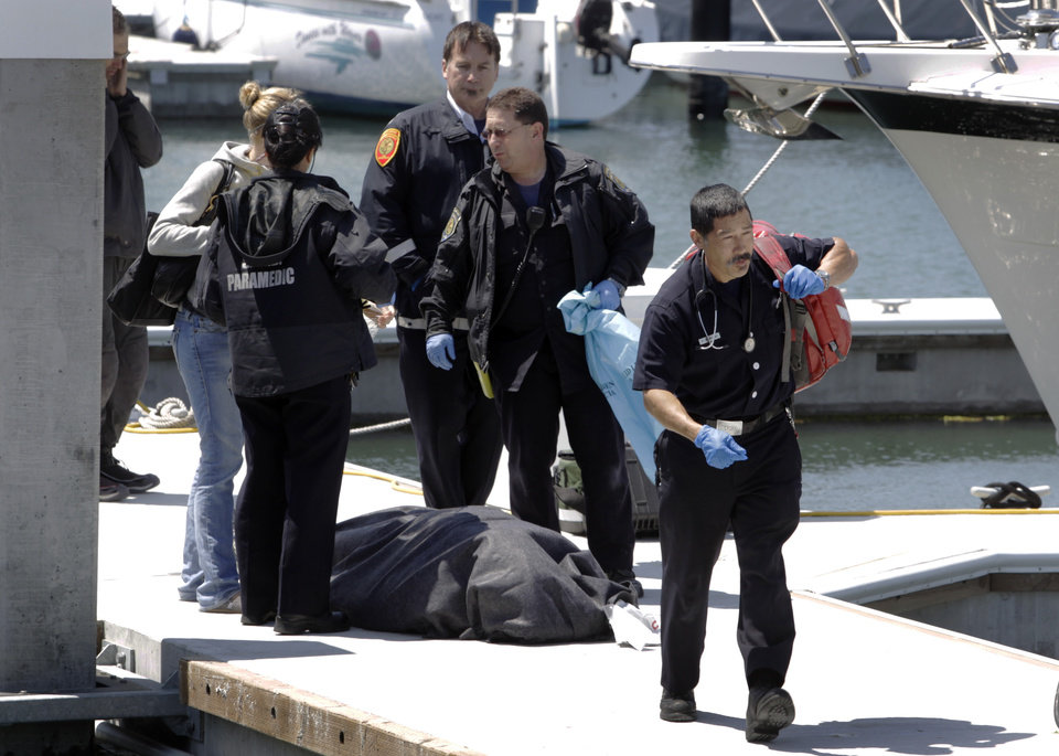 Photo - A paramedic leaves a dock in the Marina District after attempts to save sailor Andrew Simpson, of Great Britain, were unsuccessful, Thursday, May 9, 2013, in San Francisco, Calif. Simpson died after the Artemis Racing AC72 catamaran, an America's Cup entry from Sweden, capsized during training in San Francisco Bay, the team said.  (AP Photo/San Francisco Chronicle, Paul Chinn) EXAMINER OUT. MAGS OUT; NO SALES, NORTHERN CALIFORNIA NEWSERPAPERS MANDATORY CREDIT