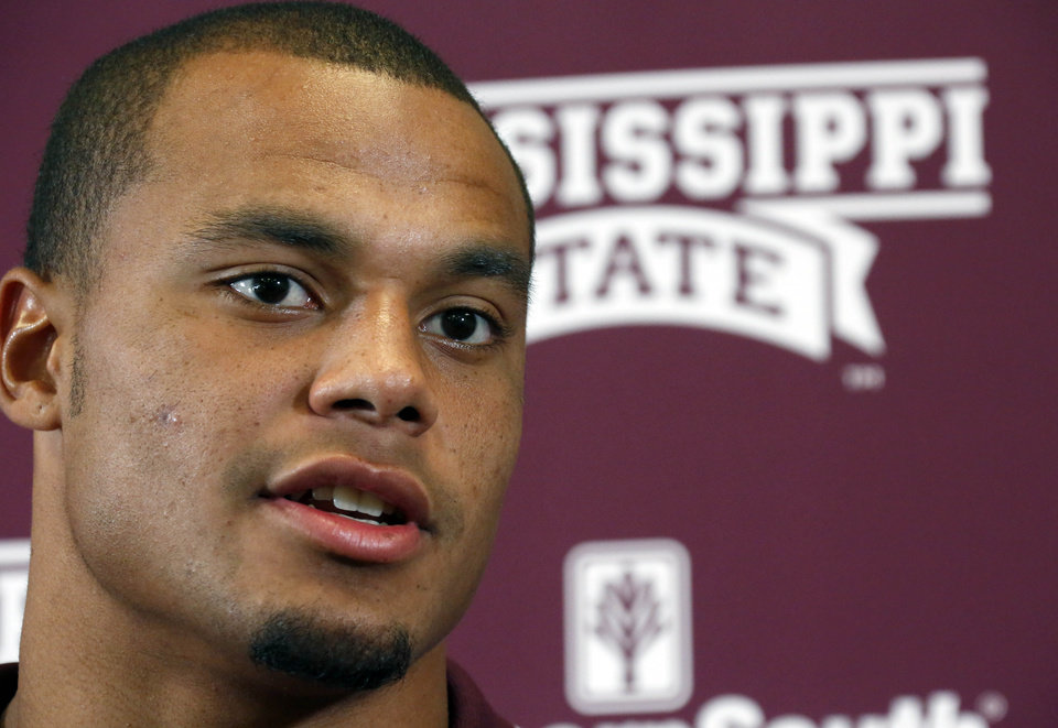 Photo - Mississippi State quarterback Dak Prescott responds to a reporter's question during the NCAA college football team's media day, Saturday, Aug. 2, 2014, in Starkville, Miss. (AP Photo/Rogelio V. Solis)