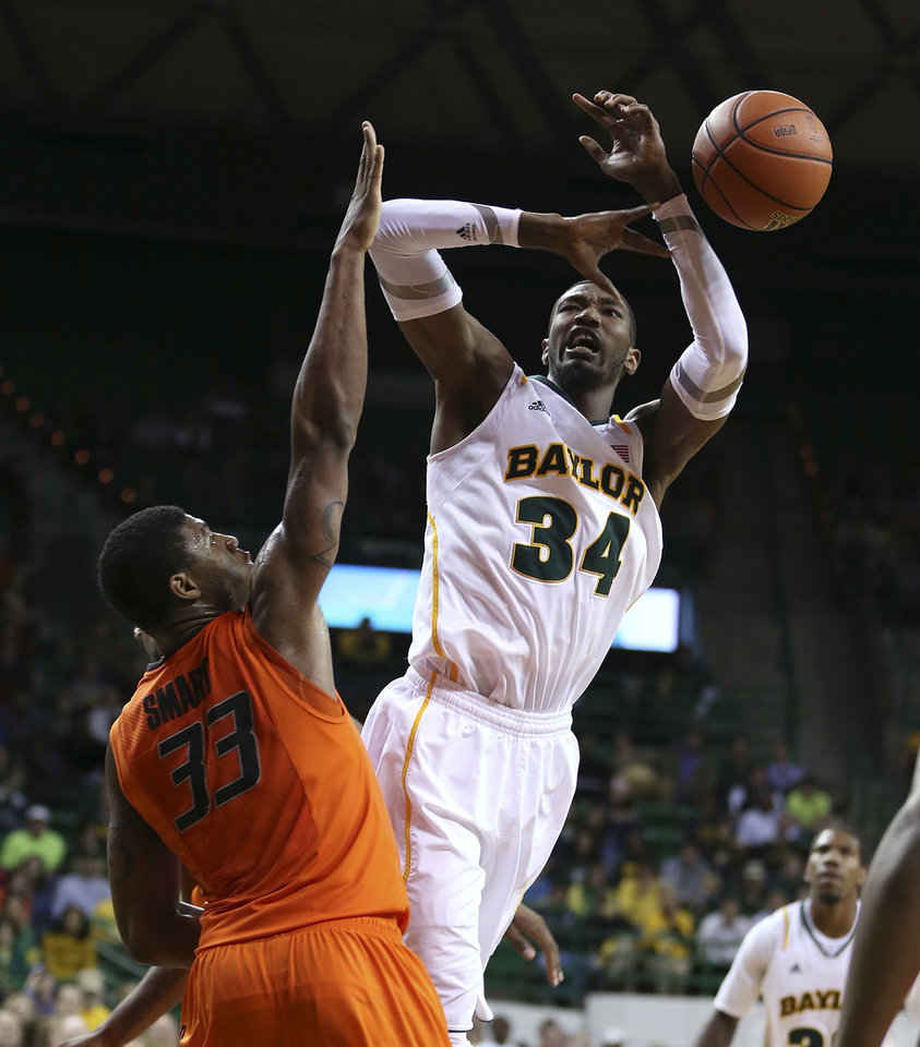 Baylor's Cory Jefferson, right, loses the ball while driving on Oklahoma State's Marcus Smart during the second half of an NCAA college basketball game, Monday, Jan. 21, 2013, in Waco, Texas. Baylor won 64-54. (AP Photo/Waco Tribune Herald, Rod Aydelotte) ORG XMIT: TXWAC106