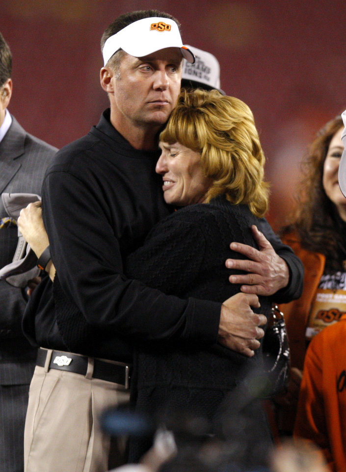 Photo - Oklahoma State coach hugs Shelley Budke after winning the Fiesta Bowl between the Oklahoma State University Cowboys (OSU) and the Stanford Cardinal at the University of Phoenix Stadium in Glendale, Ariz., Tuesday, Jan. 3, 2012. Photo by Bryan Terry, The Oklahoman