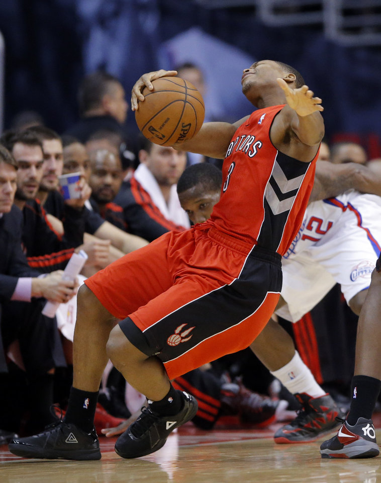 Toronto Raptors' Kyle Lowry falls to the court in the first half of an NBA basketball game against the Los Angeles Clippers in Los Angeles, Sunday, Dec. 9, 2012. (AP Photo/Jae C. Hong)