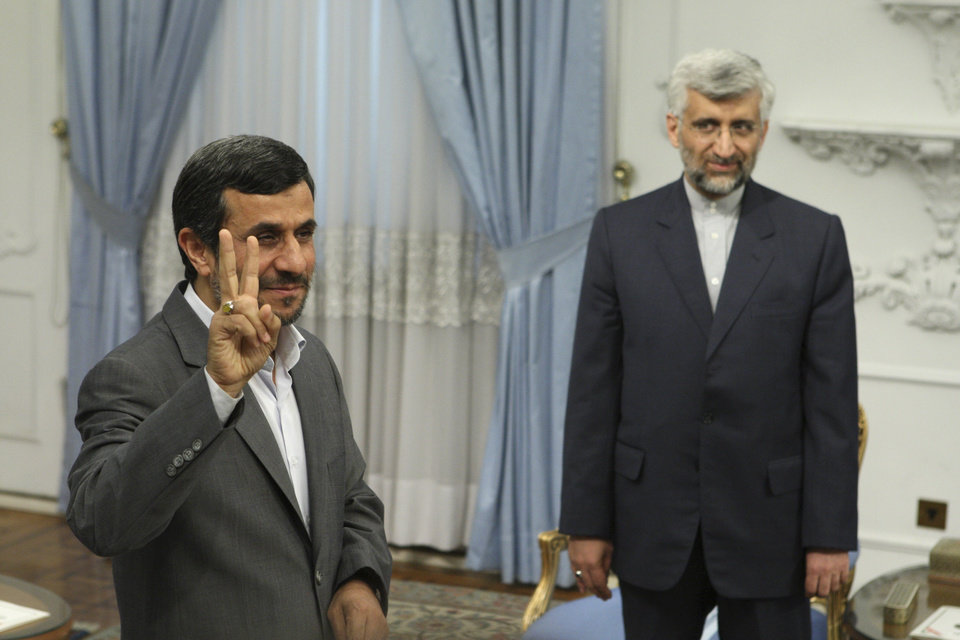FILE - In this Tuesday, Aug. 16, 2011 file photo, Iranian President Mahmoud Ahmadinejad, left, flashes a victory sign, as Iran\'s top nuclear negotiator Saeed Jalili, looks on, prior to their meeting with Russia\'s Security Council Secretary, Nikolai Patrushev, at the presidency office, in Tehran, Iran. Iran has made no secret of its hopes for the next round of nuclear negotiations with world powers: Possible pledges by the West to ease sanctions as a step toward deal making by Tehran. (AP Photo/Vahid Salemi, File)
