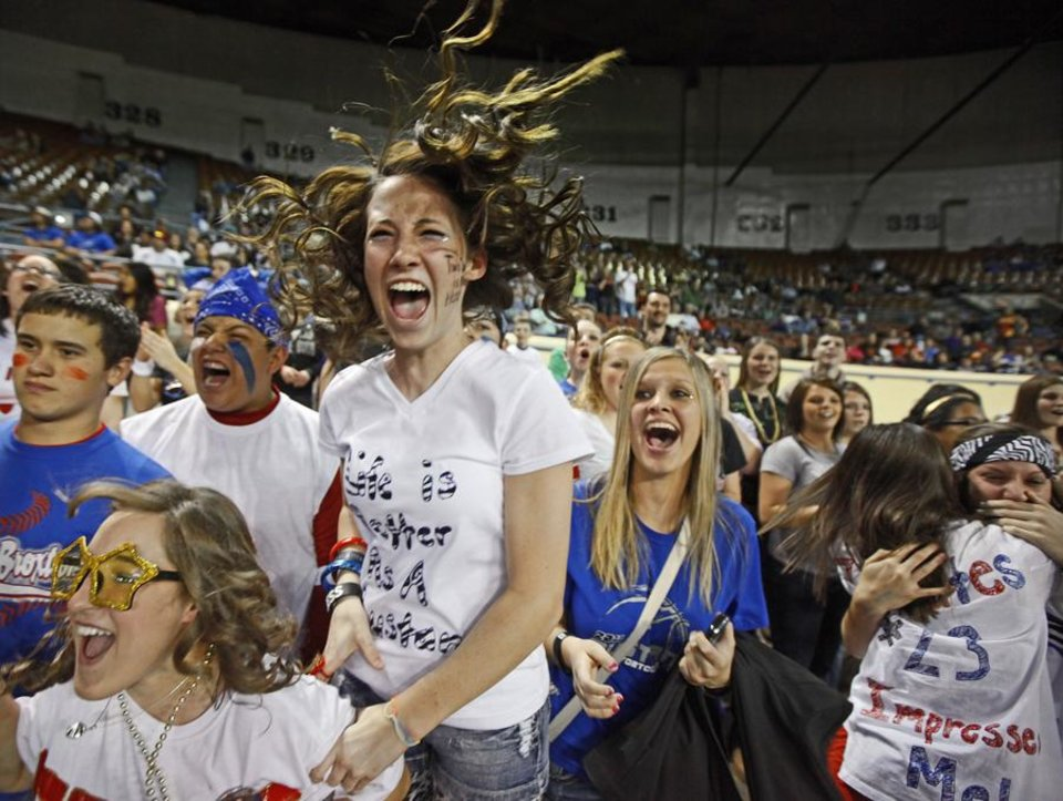 Carson Perry, 17, at left, Ashlyn Yancey, 15, and Katie Hart, 14, react as Fort Cobb-Broxton wins the boys Class A boys basketball state tournament championship game between over Cheyenne-Reydon at State Fair Arena in Oklahoma City, Saturday, March 5, 2011. Photo by Bryan Terry, The Oklahoman ORG XMIT: KOD