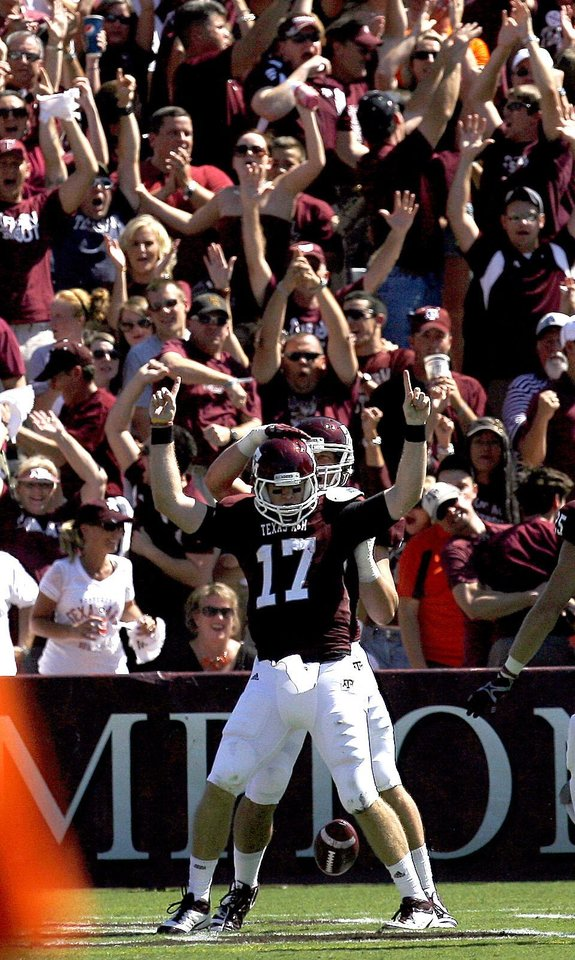Texas A&M 's Ryan Tannehill (17) celebrates a touchdown in the first half during the Aggies game vs. Oklahoma State on Saturday in College Station, Texas. Photo by Sarah Phipps, The Oklahoman