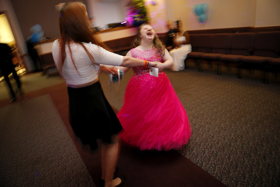 Photo - Melody Wilson, right, dances with volunteer Dilys Donohoo during