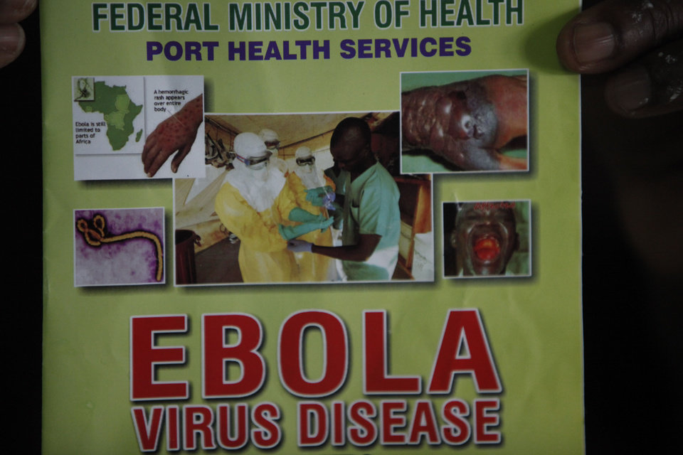 Photo - Nigeria health official display a leaflet explaining Ebola Virus Disease at the arrival hall of Murtala Muhammed International Airport in Lagos, Nigeria, Monday, Aug. 4, 2014. Nigerian authorities on Monday confirmed a second case of Ebola in Africa's most populous country, an alarming setback as officials across the region battle to stop the spread of a disease that has killed more than 700 people. (AP Photo/Sunday Alamba)