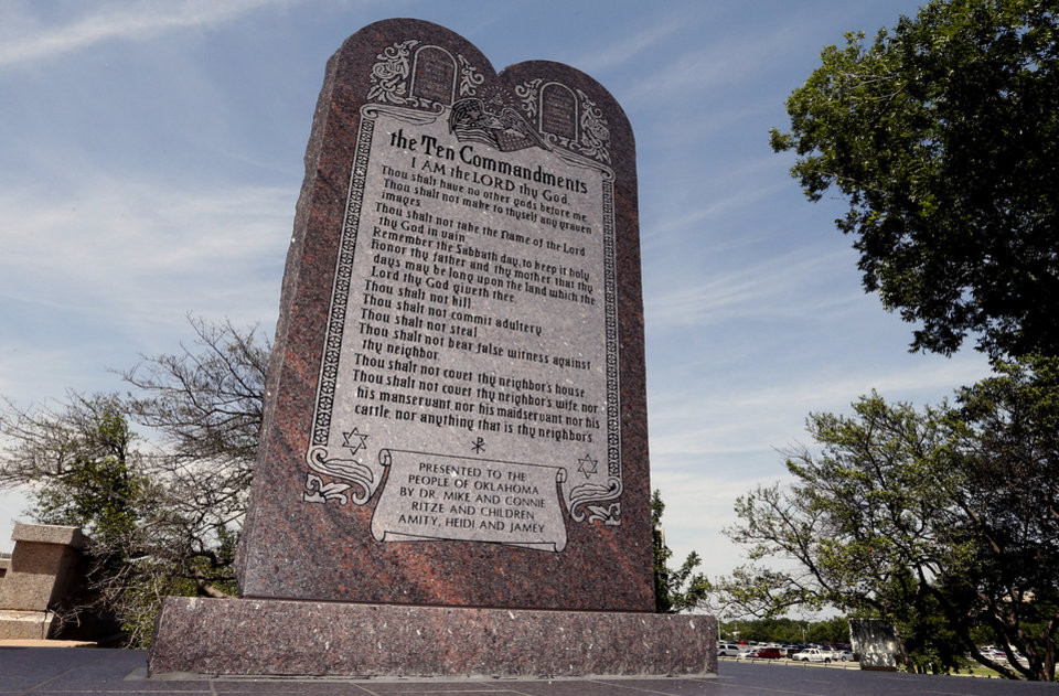 Photo - File - This June 20, 2014 file photo is the Ten Commandments monument at the state Capitol in Oklahoma City. The privately funded monument on the grounds of the Oklahoma Capitol does not violate the state constitution and can stay there, an Oklahoma County judge said Friday, Sept. 19, 2014 in a ruling that attorneys who filed the lawsuit in question vowed to appeal to the state Supreme Court. (AP Photo/Sue Ogrocki, File)