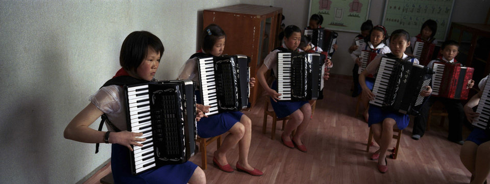 Photo - In this April 3, 2012 photo, North Korean students practice playing the accordions at the Samjiyon Schoolchildrens' Palace in Samjiyon, North Korea. The facility was built for children to take part in after school programs in the arts, sciences, sports, computer and vocational training. (AP Photo/David Guttenfelder)