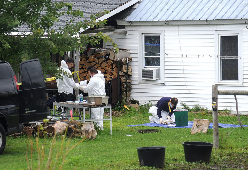 Photo - New York State Police crime scene investigators look through documents Sunday, Aug. 14, 2014, at the home of suspected kidnappers Stephen Howells II and Nicole F. Vaisey, in Hermon, NY. The father of two Amish girls abducted in northern New York last week said he feels sorry for the two people authorities say kidnapped and sexually abused his daughters. (AP Photo/Melanie Kimbler-Lago, Watertown Daily Times)