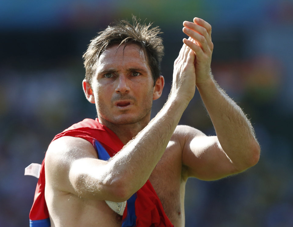 Photo - England's Frank Lampard greets England fans after the group D World Cup soccer match between Costa Rica and England at the Mineirao Stadium in Belo Horizonte, Brazil, Tuesday, June 24, 2014.  The match ended in a 0-0 draw. (AP Photo/Jon Super)
