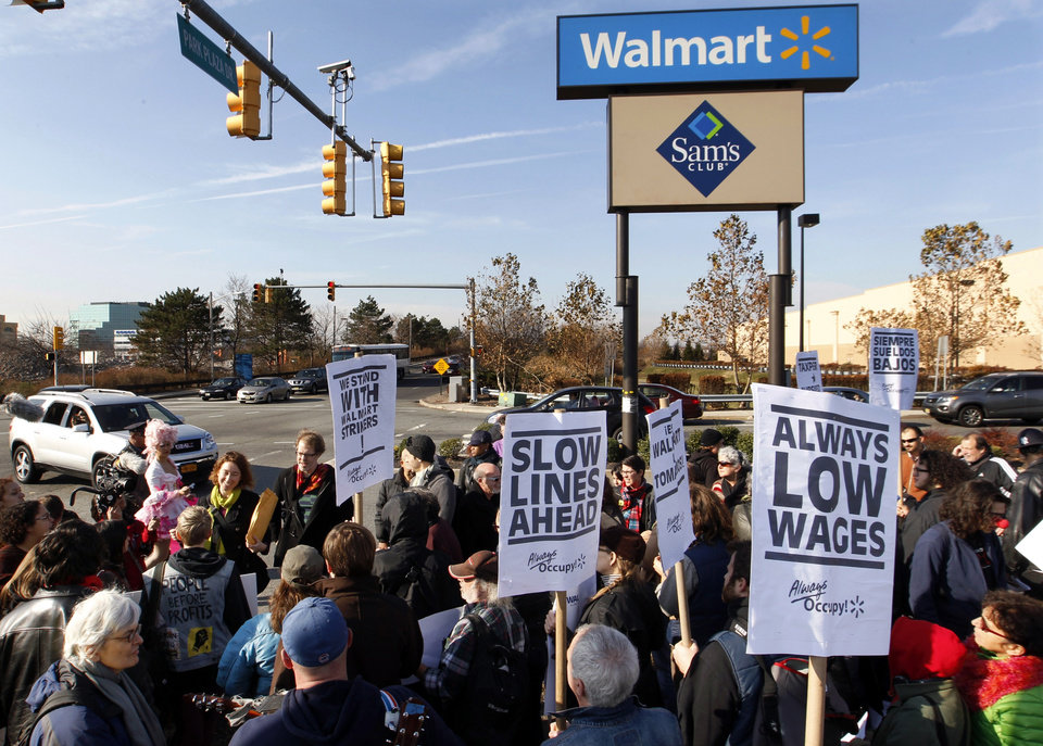 Photo -   A large gathering protests against Wal-Mart on Black Friday, Nov 23, 2012, in Secaucus, N.J. Wal-Mart employees and union supporters are taking part in today's nationwide demonstration for better pay and benefits A union-backed group called OUR Walmart, which includes former and current workers, was staging the demonstrations and walkouts at hundreds of stores on Black Friday, the day when retailers traditionally turn a profit for the year. (AP Photo/Mel Evans)