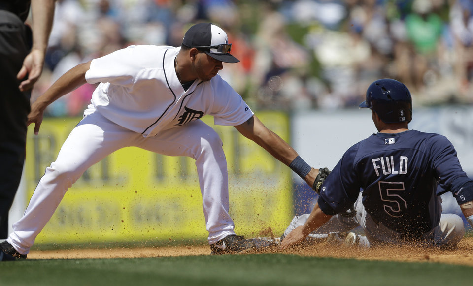 Photo - Tampa Bay Rays' Sam Fuld is tagged out at second by Detroit Tigers shortstop Jhonny Peralta on a steal attempt during the fourth inning of a spring training baseball game, Friday, March 29, 2013 in Lakeland, Fla. (AP Photo/Carlos Osorio)