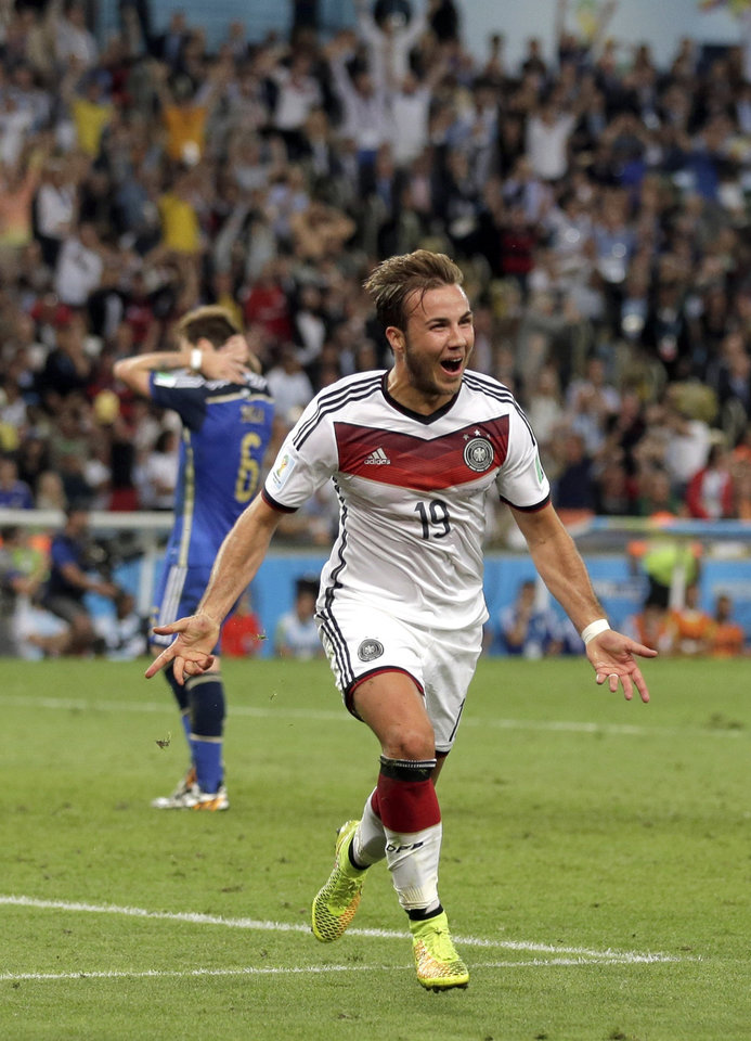 Photo - Germany's Mario Goetze celebrates after scoring his side's first goal in extra time against Argentina's goalkeeper Sergio Romero during the World Cup final soccer match between Germany and Argentina at the Maracana Stadium in Rio de Janeiro, Brazil, Sunday, July 13, 2014. (AP Photo/Felipe Dana)