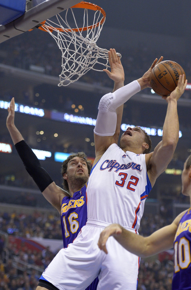 Los Angeles Clippers forward Blake Griffin, right, puts up a shot as Los Angeles Lakers forward Pau Gasol, of Spain, defends during the first half of their NBA basketball game, Friday, Jan. 4, 2013, in Los Angeles.  (AP Photo/Mark J. Terrill)