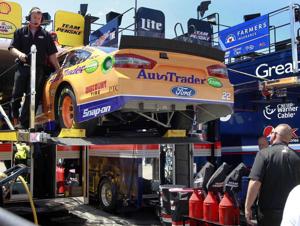Photo - Driver Joey Logano's crew unloads his backup car during practice for Sunday's NASCAR Sprint Cup series auto race at New Hampshire Motor Speedway, Friday, July 11, 2014, in Loudon, N.H. Logano crashed his first car during practice.  (AP Photo/Jim Cole)