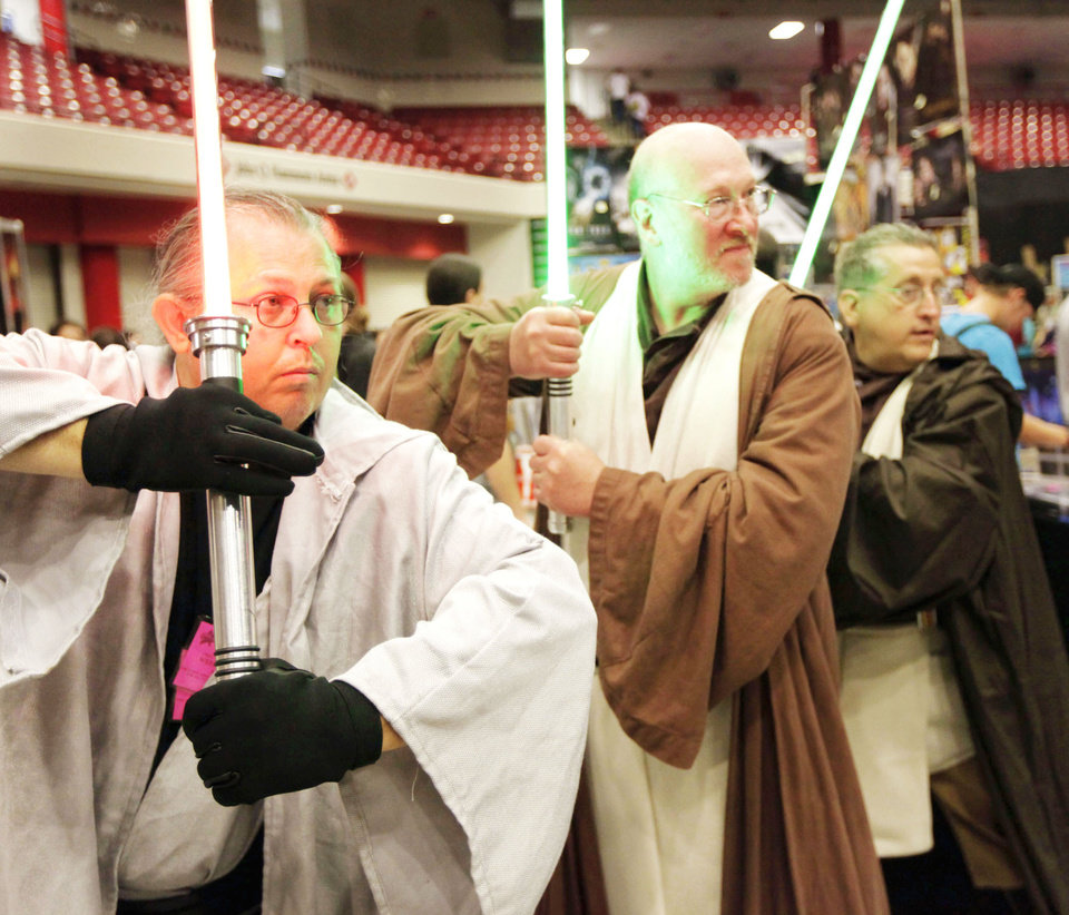"Above: Robert Collins as Dark Lord Waya Night Walker, Scott Lang as Lan/Ed Tul and Anthony Pagano as Jedi Anton pose as characters from ""Star Wars"" Saturday during Trek Expo."