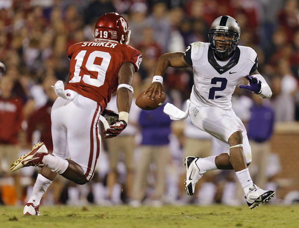 Photo - TCU 's Trevone Boykin (2) looks to get past Oklahoma's Eric Striker (19) during the college football game between the University of Oklahoma Sooners (OU) and the Texas Christian University Horned Frogs (TCU) at the Gaylord Family-Oklahoma Memorial Stadium on Saturday, Oct. 5, 2013 in Norman, Okla.   Photo by Chris Landsberger, The Oklahoman
