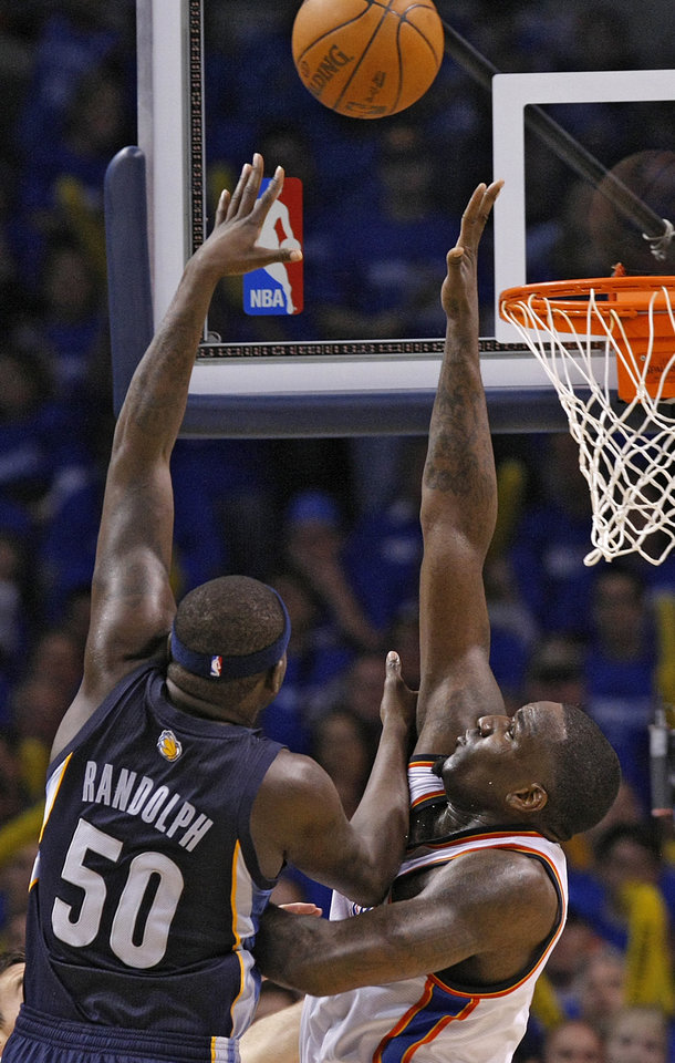 Photo - Memphis' Zach Randolph (50) lays up a shot over Oklahoma City's Kendrick Perkins (5) during game one of the Western Conference semifinals between the Memphis Grizzlies and the Oklahoma City Thunder in the NBA basketball playoffs at Oklahoma City Arena in Oklahoma City, Sunday, May 1, 2011. Photo by Chris Landsberger, The Oklahoman