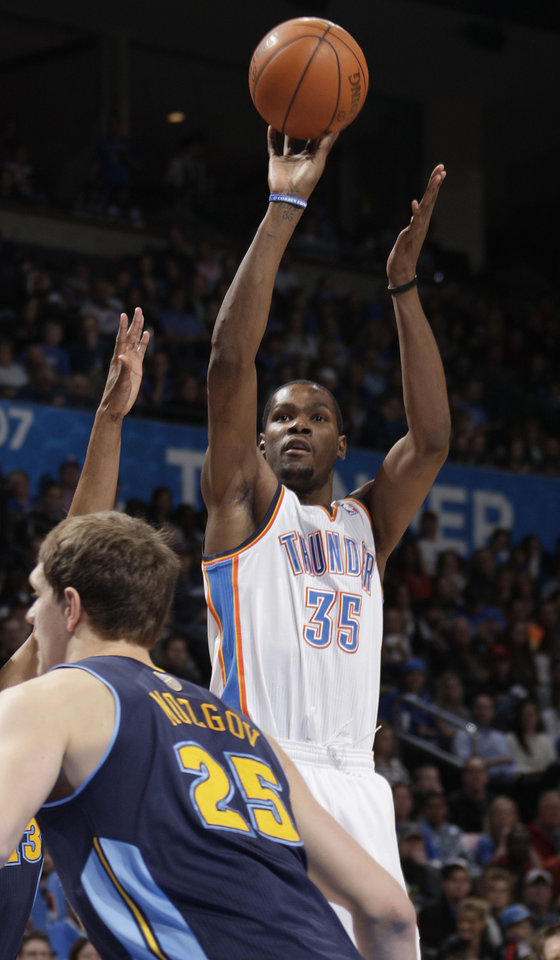 Photo - Oklahoma City's Kevin Durant (35) shoots over Denver's Timofey Mozgov (25) during the NBA basketball game between the Oklahoma City Thunder and the Denver Nuggets at the Chesapeake Energy Arena, Sunday, Feb. 19, 2012. Photo by Sarah Phipps, The Oklahoman