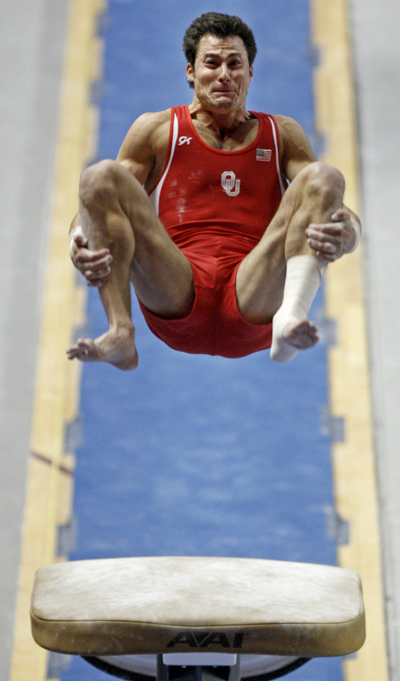 Photo - Oklahoma's Patrick Piscitelli competes on the vault during the men's NCAA college gymnastics championships in at the Lloyd Noble Center in Norman, Okla., Thursday, April19, 2012. Photo by Bryan Terry, The Oklahoman