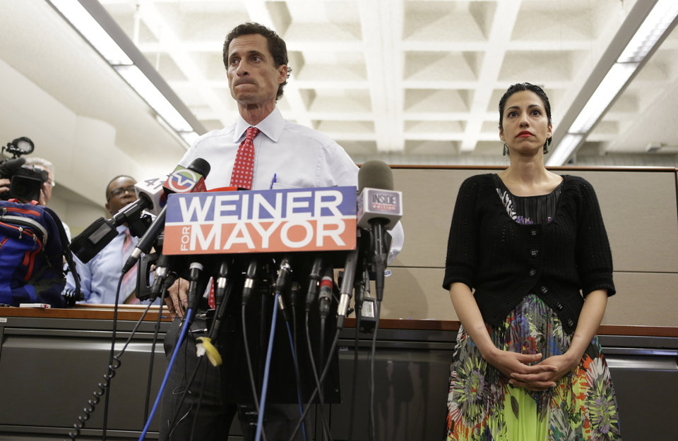 Photo - New York mayoral candidate Anthony Weiner speaks during a news conference alongside his wife Huma Abedin at the Gay Men's Health Crisis headquarters, Tuesday, July 23, 2013, in New York.  The former congressman says he's not dropping out of the New York City mayoral race in light of newly revealed explicit online correspondence with a young woman. (AP Photo/John Minchillo)