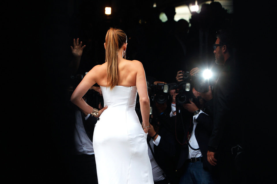 Photo - Singer Jennifer Lopez poses for photographers, prior to the Atelier Versace Fall Winter 2014-15  Haute Couture fashion collection, presented in Paris, Sunday, July 6, 2014. (AP Photo/Thibault Camus)