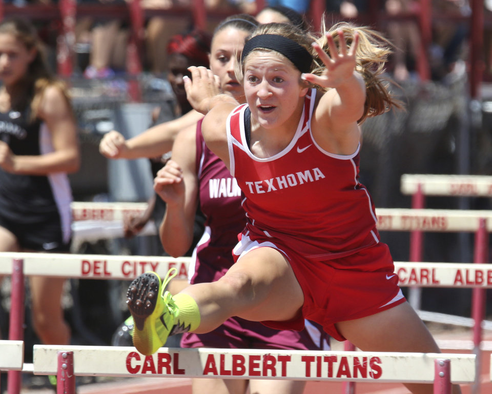 Photo - Randi Yates of Texhoma wins the 100 meter hurdles at Carl Albert high school in Midwest City, Friday May 09, 2014. Photo By Steve Gooch, The Oklahoman