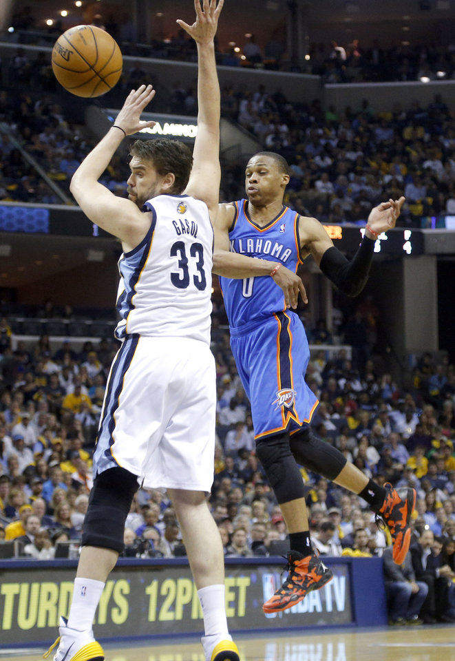 Photo - Oklahoma City's Russell Westbrook (0) passes the ball round Memphis' Marc Gasol (33) during Game 6  in the first round of the NBA playoffs between the Oklahoma City Thunder and the Memphis Grizzlies at FedExForum in Memphis, Tenn., Thursday, May 1, 2014. Photo by Bryan Terry, The Oklahoman