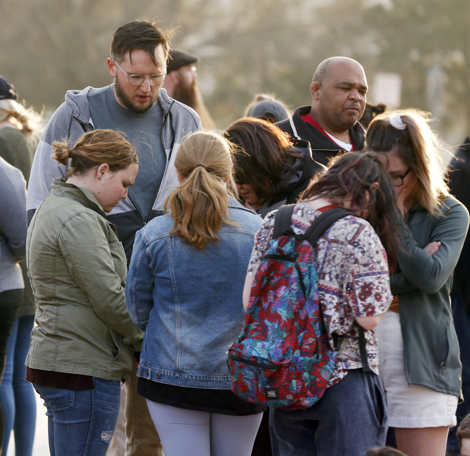 Photo - People pray during the Churches for Teachers Prayer Vigil, an event supporting Oklahoma teachers and students, on the south side of the state Capitol in Oklahoma City, Thursday, March 15, 2018. Photo by Nate Billings, The Oklahoman