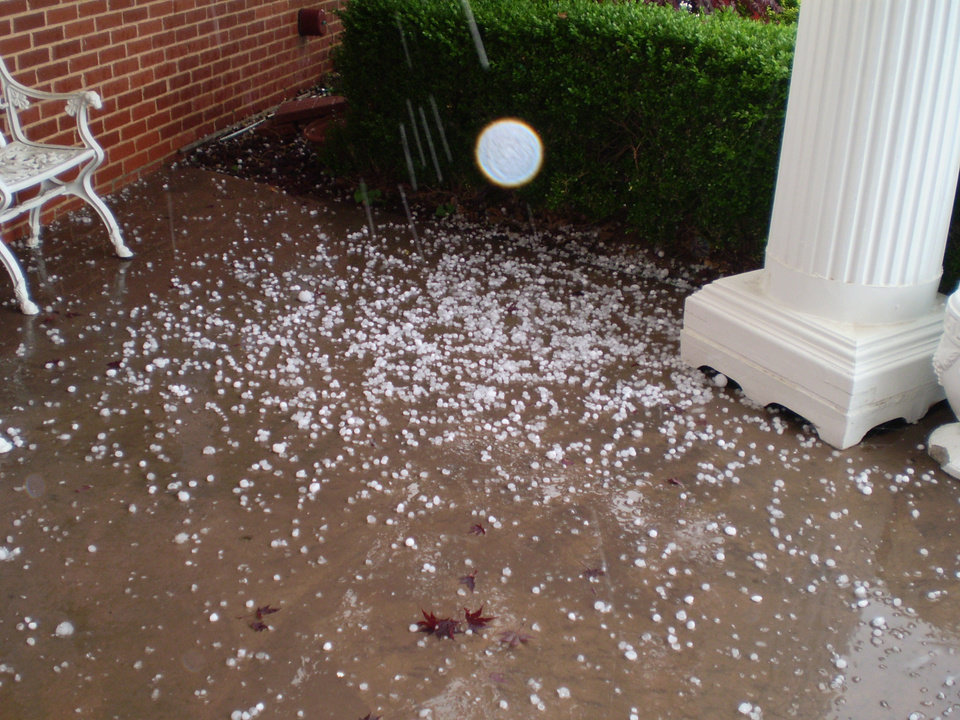 Hail flying onto the porch<br/><b>Community Photo By:</b> Tonua Hulette<br/><b>Submitted By:</b> Tonua, Midwest City