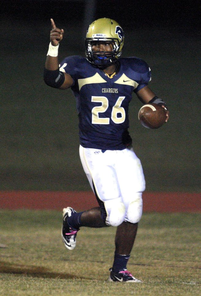 Photo - Heritage Hall's Barry Sanders celebrates a touchdown during the high school football game between Heritage Hall and Bethany at Heritage Hall in Oklahoma City, Friday, Oct. 28, 2011. Photo by Sarah Phipps, The Oklahoman