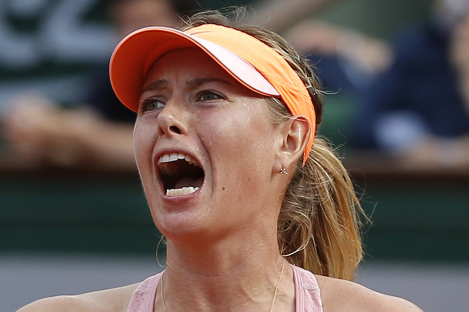 Photo - Russia's Maria Sharapova reacts as she plays Romania's Simona Halep during their final match of  the French Open tennis tournament at the Roland Garros stadium, in Paris, France, Saturday, June 7, 2014. (AP Photo/Michel Euler)