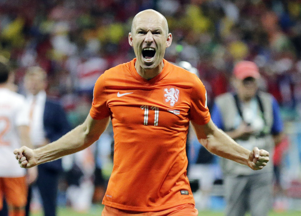 Photo - Netherlands' Arjen Robben celebrates after the Netherlands defeated Costa Rica 4-3 in a penalty shootout after a 0-0 tie during the World Cup quarterfinal soccer match at the Arena Fonte Nova in Salvador, Brazil, Saturday, July 5, 2014.(AP Photo/Wong Maye-E)