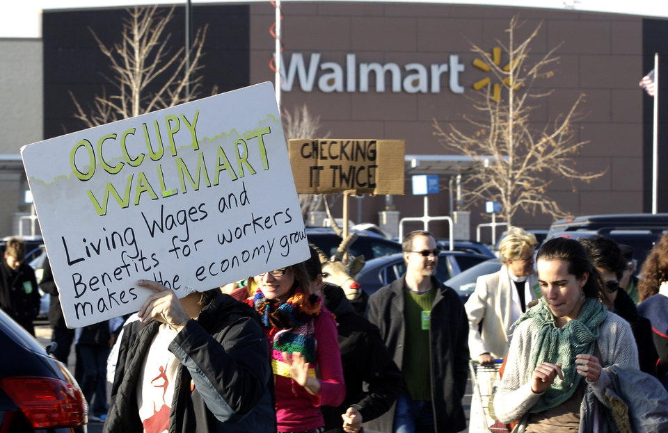Photo -   People protest against Wal-Mart on Black Friday, Nov 23, 2012, in Secaucus, N.J. Wal-Mart employees and union supporters are taking part in today's nationwide demonstration for better pay and benefits. A union-backed group called OUR Walmart, which includes former and current workers, was staging the demonstrations and walkouts at hundreds of stores on Black Friday, the day when retailers traditionally turn a profit for the year. (AP Photo/Mel Evans)