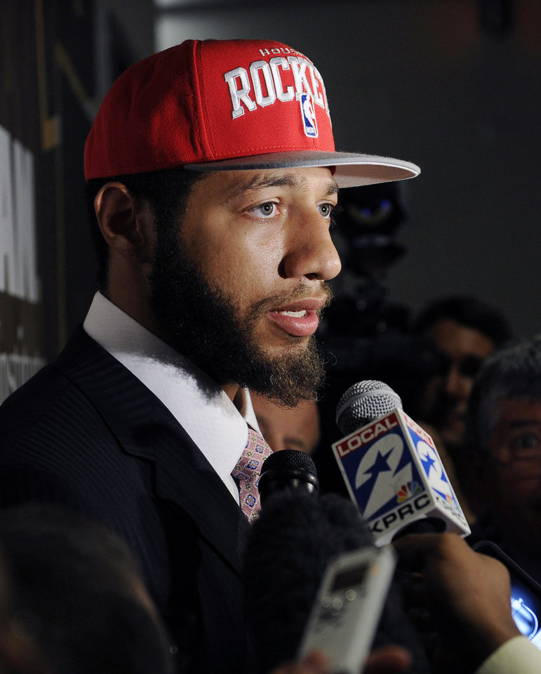Photo -   FILE - In this June 29, 2012, file photo, Houston Rockets first-round draft pick Royce White speaks with the media at a newws conference in Houston. In October, NBA rookie Royce White disclosed that he is afraid to fly and said he expects to travel by bus to play in at least some of the basketball games for his team, the Houston Rockets. But psychologists and many travelers who've overcome their terror of airplanes say if he might be able to ditch the bus if he can get treatment for the condition. (AP Photo/Pat Sullivan, File)