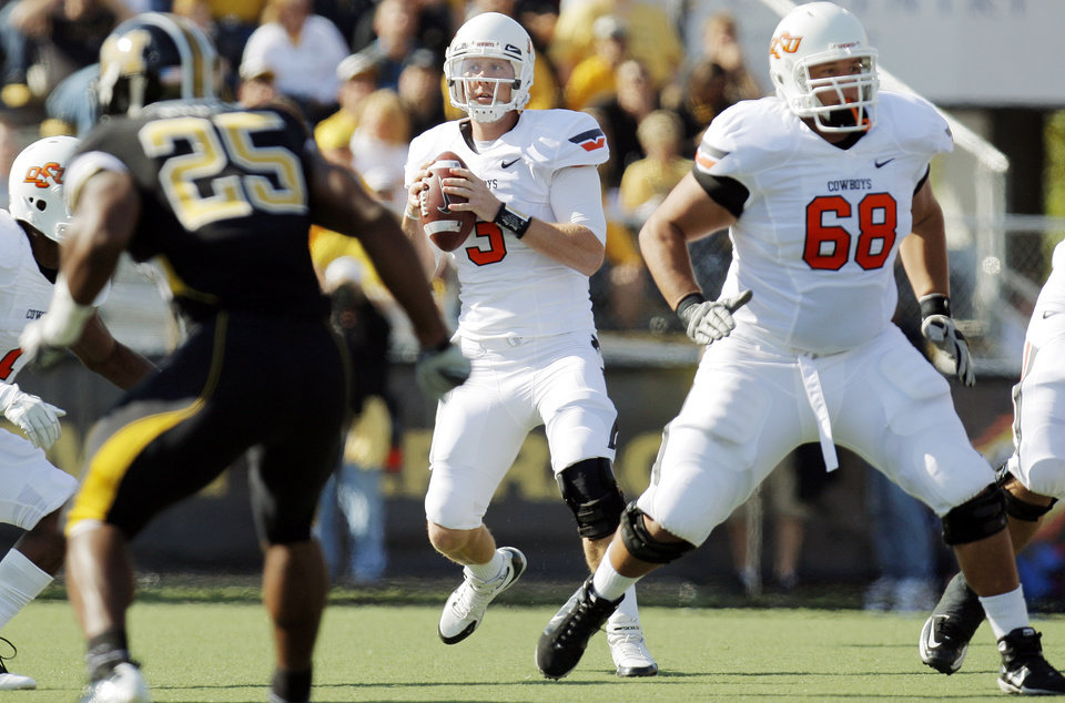 Photo - Oklahoma State's Brandon Weeden (3) drops back to pass behind Lane Taylor (68) during a college football game between the Oklahoma State University Cowboys (OSU) and the University of Missouri Tigers (Mizzou) at Faurot Field in Columbia, Mo., Saturday, Oct. 22, 2011. Photo by Nate Billings, The Oklahoman ORG XMIT: KOD