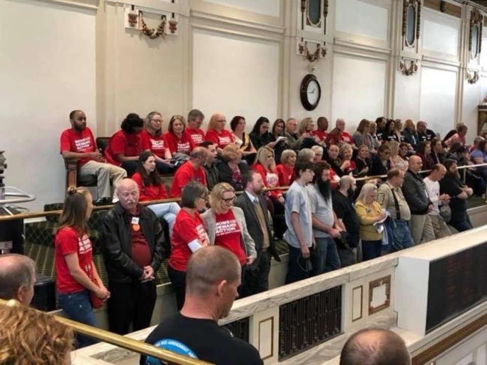 Photo -  Moms Demand Action for Gun Sense in America volunteers wearing red shirts are pictured in the House gallery during a gun-related bill debate on the floor. [Photo provided]