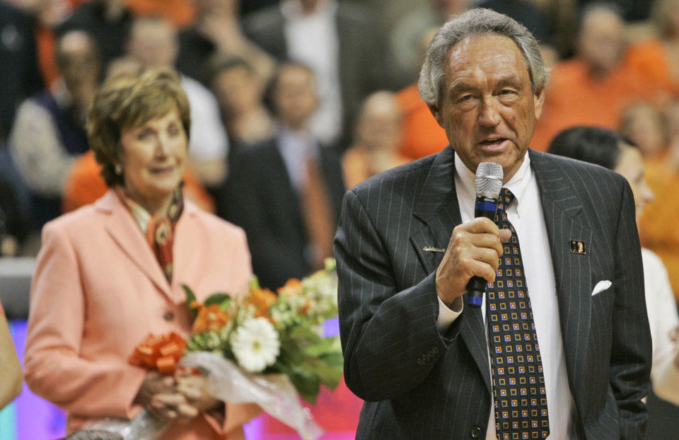 Former Oklahoma State coach Eddie Sutton speaks to the crowd at halftime of a men's NCAA basketball game against Texas A&M in Stillwater, Okla., Wednesday, Feb. 21, 2006. Sutton was honored by the school for his long coaching career. Looking on at left is his wife, Patsy Sutton.(AP Photo/Sue Ogrocki)
