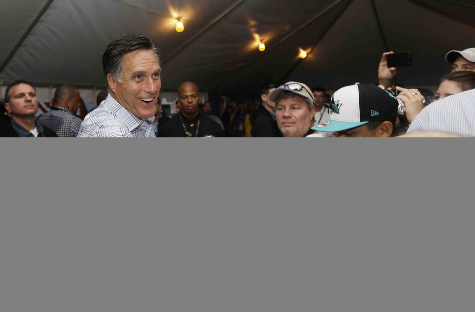 Photo -   Republican presidential candidate Mitt Romney hands out hot dogs as he campaigns at the Federated Auto Parts 400 NASCAR Sprint Cup Series race at Richmond International Raceway in Richmond, Va., Saturday, Sept. 8, 2012. (AP Photo/Charles Dharapak)