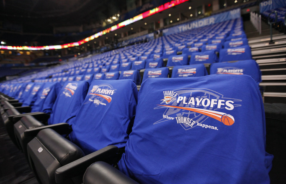 Photo - Oklahoma City Thunder Playoff shirts cover the seats in the Oklahoma City Arena before the start of the first round NBA playoff game between the Oklahoma City Thunder and the Denver Nuggets on Sunday, April 17, 2011, in Oklahoma City, Okla. Photo by Chris Landsberger, The Oklahoman